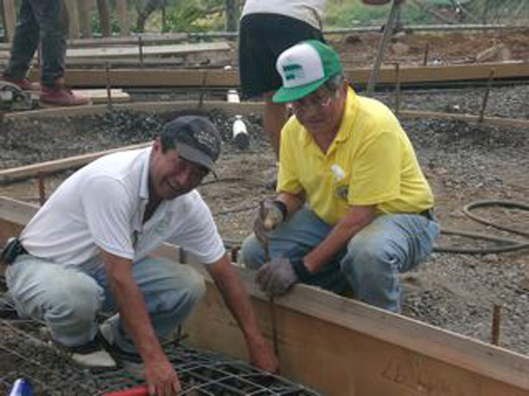 Members of the Lions Club do preparation work before the concrete pour for the second pavilion and walkway. (Photo courtesy of Cliff Kopp)