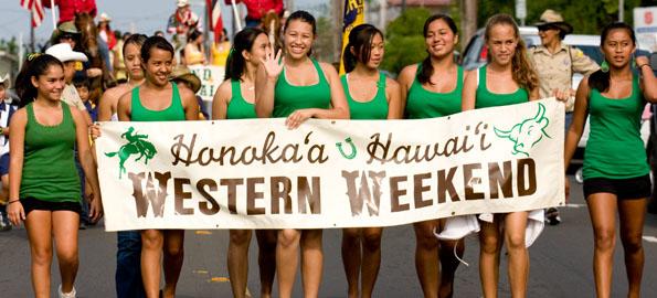 The Honokaa cheer squad heads down Mamane Street in the Honokaa Western Week Paniolo Parade