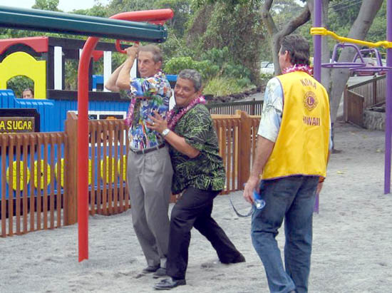 Cliff Kopp gets push from Mayor Billy Kenoi as Bob Lovein, Kona Lion and playground volunteer, looks on. Kopp was the first to test out the new 20-foot zipline, which is actually designed for keiki! (Hawaii247.com photo courtesy of  Cliff Kopp)