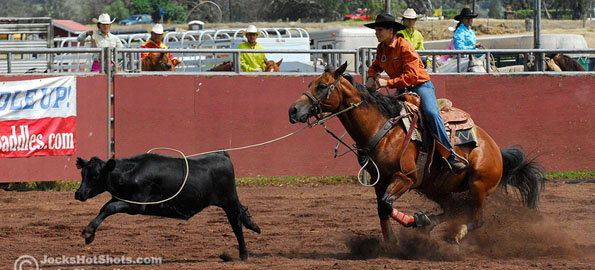 Macey Loando ropes a calf during Friday rodeo action at Parker Ranch Paniolo Park in Waimea.