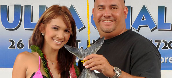 Tournament Queen Sonja Soun along with fisherman Randy Duldulao with a 18.7 pound Omilu. Click on the image above to see the story and rest of the...fish.