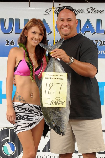 In the Omilu division, Randy Duldulao brought in an 18.7-pound omilu. He caught the fish on Friday afternoon in the Kapoho area. Randy is pictured with Sonja Soun, the Tournament Queen.