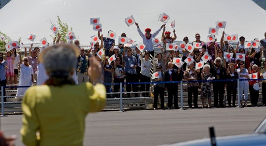 Empress Michiko waves to the crowd of supporters at Kona International Airport as they board their motorcade to the Mauna Kea Beach Resort.