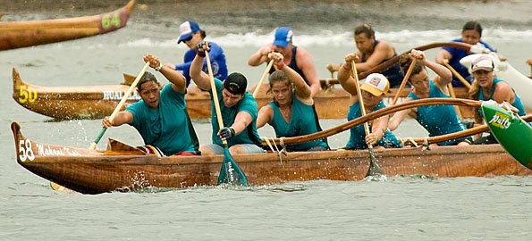 The Freshmen Women's crew from Keauhou Canoe Club leads Kai Opua to take their one-mile canoe race event in Hilo Bay Saturday (July 18).