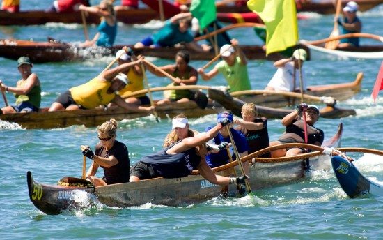 The Women's Masters (40) crews go into the first turn of the one mile race in Hilo Bay.