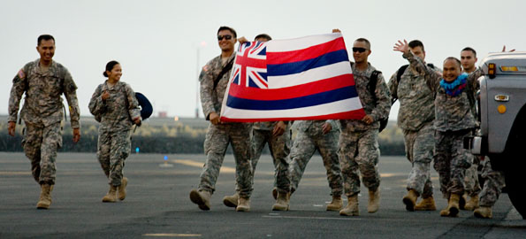 Families gather to welcome more than 100 troops home to the Big Island after second deployment in combat zone