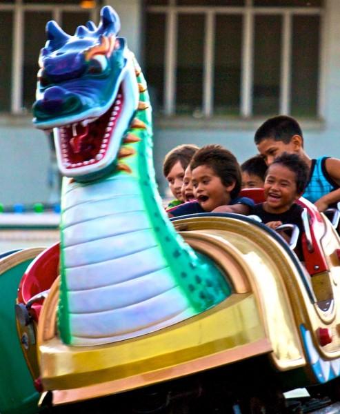 Kids enjoy a rollercoaster of a ride during the Hawaii County Fair in Hilo.