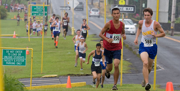 Runners head up Puainako Street during the BIIF cross country meet at Waiakea High School.