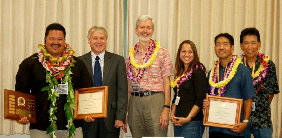 (left to right), Judd Sato, Jr., HSPLS Õ09 Employee of the Year; State Librarian Richard Burns; and members of the HSPLS Õ09 Team of the Year: ChildrenÕs Science Book Project Ð Duane Wenzel, Branch Manager; Kristine Kishida, Library Technician V; Curt Fukumoto, Librarian III; all at Salt Lake-Moanalua Public Library; and Edwin Kamikawa, Illustrator-Photographer of Library Development Services Section.  Not pictured: Ann Luke, Library Technician V of Salt Lake-Moanalua Public Library.