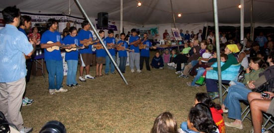 Students entertain with ukulele during the opening ceremony for Relay for Life.