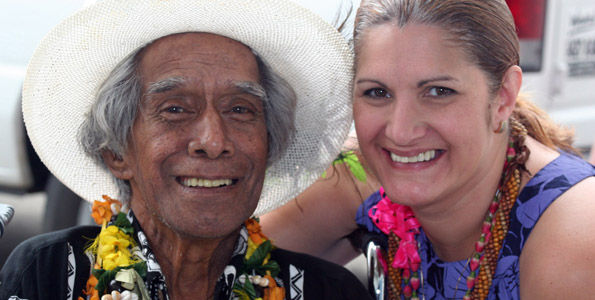 Uncle George Naope smiles and poses last year with Darlene Ahuna. (Hawaii247 photo special by Tim Wright)