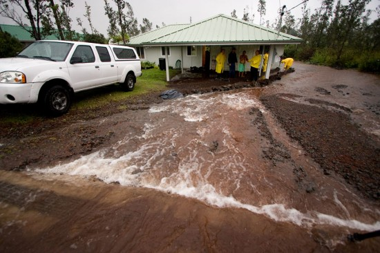 Rainwater cascades like a river down the driveway of a home in Ainaloa Subdivsion on Rainbow Drive Saturday (Nov 14). Photography by Baron Sekiya for Hawaii 24/7.