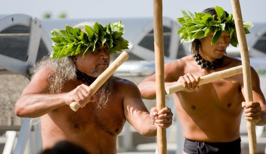 The men of Halau Kupaaina perform during the dedication of a new solar farm by Sopogy called Holaniku at Keahole Point. (Hawaii 24/7 photo by Baron Sekiya)