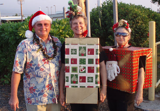 State Reps. Denny Coffman and Cindy Evans (center) were among the public officials celebrating the holiday season during Saturday's festivities.  (Hawaii 24/7 photo courtesy of Margaret Masunaga)