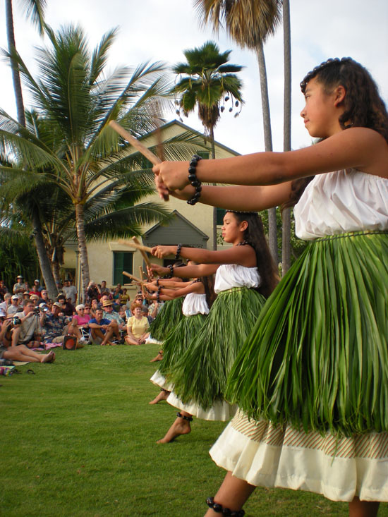 The junior wahine of Halau Na Pua Ui O Hawaii perform Sunday at Hulihee Palace. (Hawaii 24/7 photo by Karin Stanton)