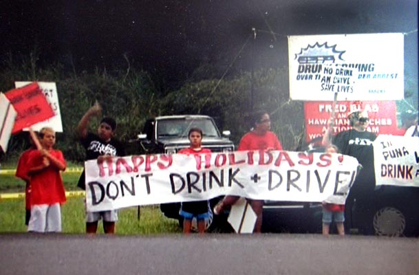 Community Police Officers from the Hawai'i Police Department are continuing their sign-waving awareness project with the Hawaiian Beaches Action Team to educate the public about the dangers of both speeding and driving under the influence of alcohol or drugs.