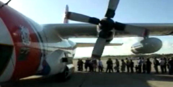 The crew of a Coast Guard C-130 Hercules fixed-wing aircraft from Air Station Barbers Point, Hawaii, evacuated more than 60 Haitian-Americans Sunday (Jan 17) from Port-au-Prince, Haiti.