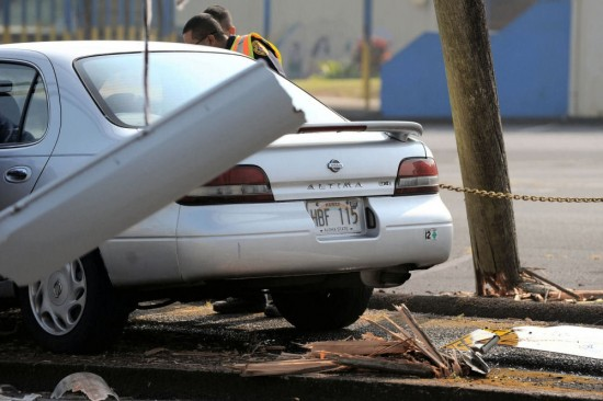 A utility pole is broken fronting the Hilo Middle School parking lot.