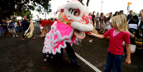 Lions, drums, cymbals and firecrackers chased away evil sprits and welcomed the Chinese Lunar New Year into Hilo Saturday (Feb 13).