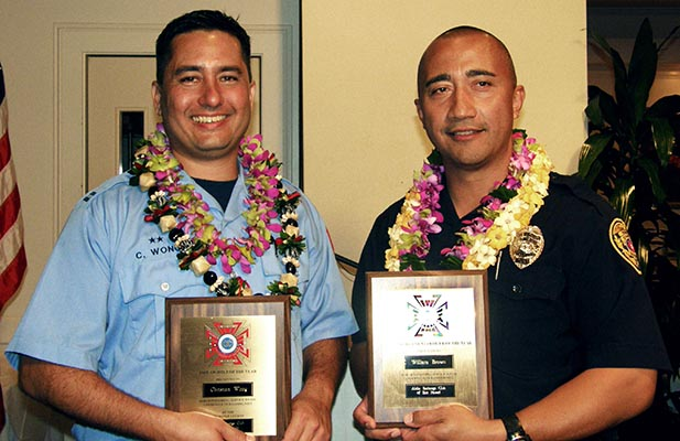 """The Aloha Exchange Club of East Hawai'i recognized Officer William """"Willie"""" Brown as """"Officer of the Year"""" and Captain Christian Wong as """"Fire Fighter of the Year"""" in a dinner ceremony Thursday evening (March 18)."""