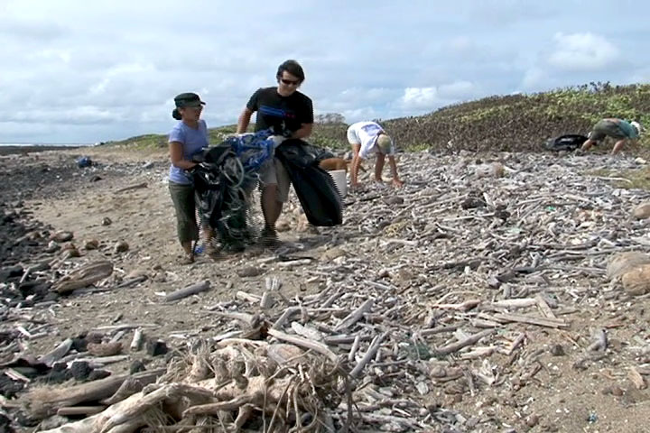 Hawaii County employees along with their family and friends worked on cleaning up Kamilo Beach in Ka'u for Earth Day on Saturday (May 1).