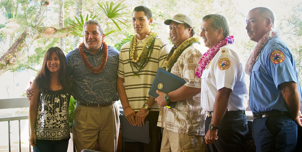 Local heroes Kekoa Namohala and Waylen Carenio receive honors from Mayor Billy Kenoi and Fire Chief Darryl Olivera for rescuing an 8th grade student.