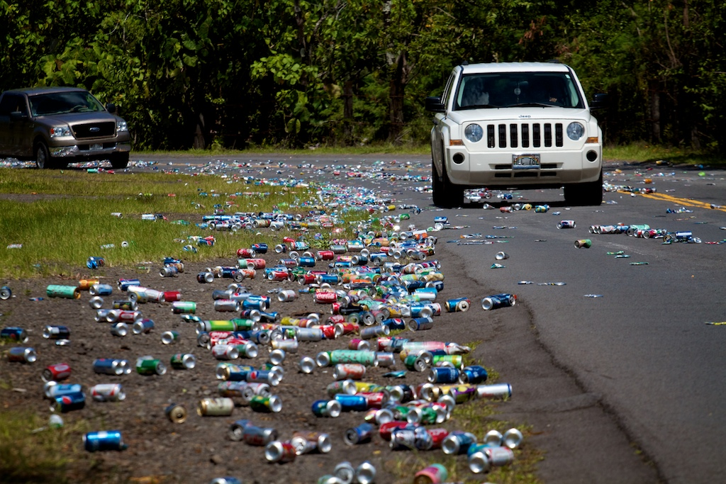 Thousands of aluminum cans spilled onto the roadway to the Hilo landfill Monday afternoon (July 12) when a truck accidentally released the load.