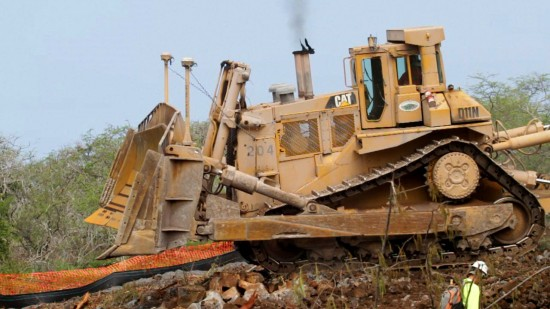 A D-11 bulldozer works on cutting the the final few hundred yards to Palani Road on the Ane Keohokalole Highway project Monday (Aug 23). Photography by Baron Sekiya   Hawaii 24/7