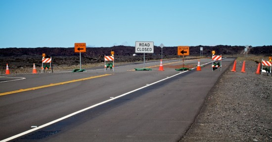 Traffic is detoured to the old section of Saddle Road on the Hilo side as fire crews battle a weeklong brushfire on the slopes of Mauna Kea. Photography by Baron Sekiya | Hawaii 24/7.