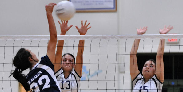 It was a battle of two unbeaten girls' volleyball teams at a packed Kamehameha-Hawaii gym Tuesday (Sept 14). To the victor would be first place in the BIIF Division I standings.
