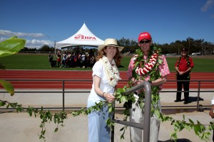 Stan Shutes and his daughter, Christina, officially open the new Stanford W. Shutes Track at Hawaii Preparatory Academy as the school's headmaster, Lindsay Barnes, looks on. Photo courtesy of HPA