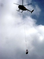 A helicopter delivers tools to firefighters in the field. Photo courtesy of National Parks Service.
