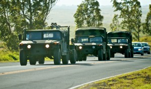 A convoy of military vehicles heads up Waikoloa Road Friday (May 27) on their way to Pohakuloa Training Area. Photography by Baron Sekiya | Hawaii 24/7
