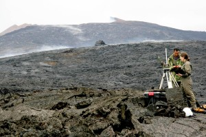 HVO geologist and helicopter pilot repair a mobile Webcam on Kupaianaha to continue monitoring the east flank of Pu`u `Ō `ō. Photo courtesy of USGS/HVO