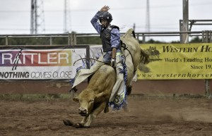 Bull rider Troy Gomes, of Kona, in the Hawaii Island High School Rodeo. Photography by Jock Goodman.