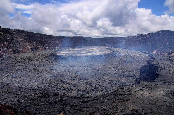 The perched lava pond within Pu`u `O`o, shown here on 29 June 2011, has been the site of dramatic growth and uplift over the past weeks. Photo by USGS/HVO