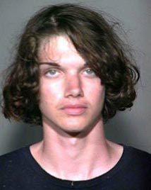 A 19-year-old Waikoloa man who was the subject of a one-and-a-half-hour manhunt is in police custody facing possible escape charges.