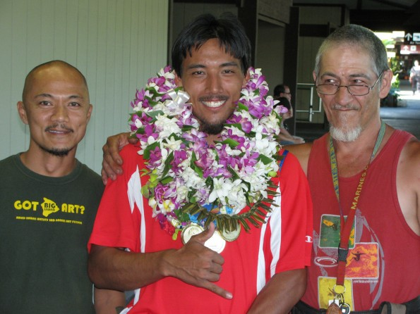 From left, professional caregiver Mar Ortaleza, Louie Perry III, and Louie's father Louie Perry Jr.