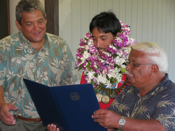 "Louie Perry III is greeted by Mayor Billy Kenoi (left) and County Councilman Fred Blas (right) and well-wishers at Hilo airport on July 6, 2011. Mayor Kenoi and Councilman Blas declared July 6, 2011 to be ""Louie Perry III Day."" Perry, of Pahoa, returned home from the Special Olympics World Summer Games in Athens, Greece with three Gold Medals in track and field events."