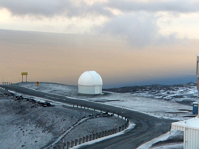 Keck Observatory engineer Andrew Cooper noted that snow began falling on the summit Wednesday afternoon (Sept 14). A time-lapse video of the Canada-France-Hawaii Telescope shows a dusting of snow falling upon Mauna Kea Thursday morning (Sept 15). Temperatures for the summit are forecast to be 39F Thursday night.