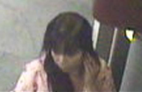 Big Island police are asking for the public's help in identifying a woman wanted for questioning in connection with a fire in a trash receptacle attached to an automated teller machine on September 8.