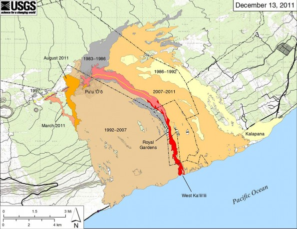 """Map showing the extent of lava flows erupted during Kilauea's ongoing east rift zone eruption and labeled with the years in which they were active. Episodes 1–48b (1983–1986) is shown in dark gray; Episodes 48c–49 (1986–1992) is pale yellow; Episodes 50–€""""53 and 55 (1992–€""""2007) is tan; Episode 54 (1997) is yellow; Episode 58 (2007–2011) is pale orange; the episode 59 Kamoamoa eruption (March 2011) is at left in light reddish orange; and the episode 60 Pu'u 'O'o overflows and flank breakout (March–August 2011) is orange. The currently active flow (episode 61) is shown as the two shades of red–pink is the extent of the flow from September 21 to November 21, and bright red marks approximate flow expansion from November 21 to December 13. The contour interval on Pu'u 'O'o is 5 m"""