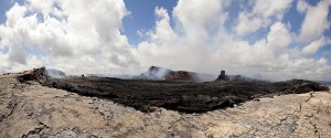 This panorama, taken from the eastern rim of Pu'u 'O'o crater, shows the broken, jumbled crater floor. In the right portion of the photograph, near the northeast rim of the crater, a collapsed cone hosted a small roiling lava pond today. Photo courtesy of USGS/HVO