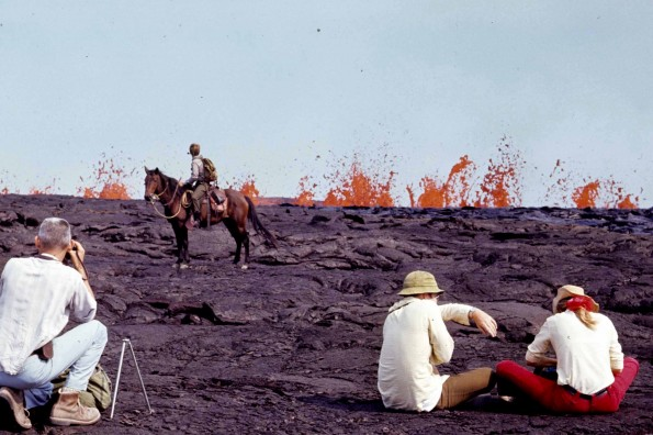 As erupting fissures migrated down Kilaueaʻ€™s southwest rift zone in September 1971 for the first time in 52 years, many spectators hiked into the Ka`u Desert for a closer view of the rare event. Hawai`i Volcanoes National Park rangers patrolled the area on horseback to keep people a safe distance from the lava fountains. Photo courtesy of NPS.