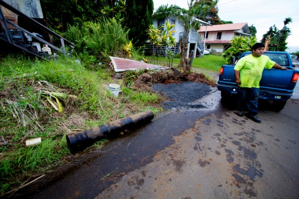 A pipe brought in to effect repairs was not used since it was a coupler and not the water main itself which was damaged. The repaired area is under the gravel covering the top of the filled trench used to access the break. Photography by Baron Sekiya | Hawaii 24/7