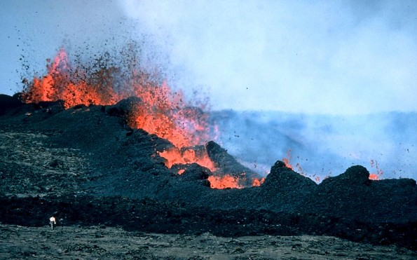 These vents on Mauna Loa's northeast rift zone were the primary source of lava during the 1984 eruption.  Note person in lower left for scale.  Photo was taken on March 26, 1984. Photo courtesy of USGS/HVO