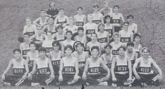 Waiakea High School cross country team, with Peter Sur to the lower left and Coach Wayne Joseph to the upper left.