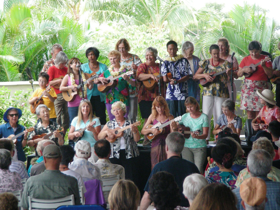 Roy Sakuma performs with his workshop students at the 2012 Great Waikoloa Ukulele Festival. (Photo courtesy of Queens' MarketPlace)