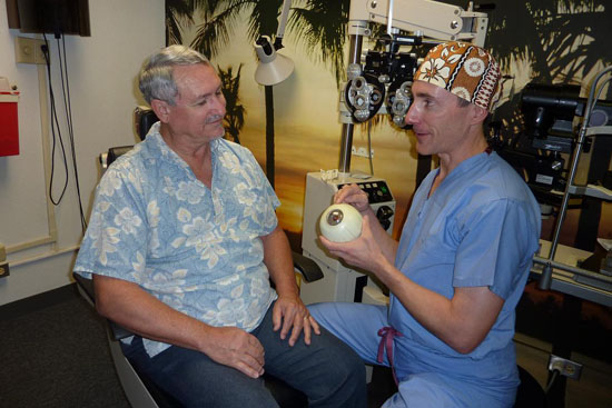 Dr. Christopher Tortora talks with a patient about dry eye disease. (Photo courtesy of Hawaiian Eye Center)
