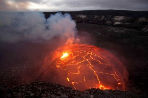 An active lava lake is contained within the Overlook crater, within Halema'uma'u Crater at the summit of Kilauea Volcano.  The summit eruption began on March 19, 2008 and is now nearly five years old.  The Hawaiian Volcano Observatory and Jaggar Museum are visible as a small bump on the horizon in the upper right portion of the image.  Photo courtesy of USGS/HVO